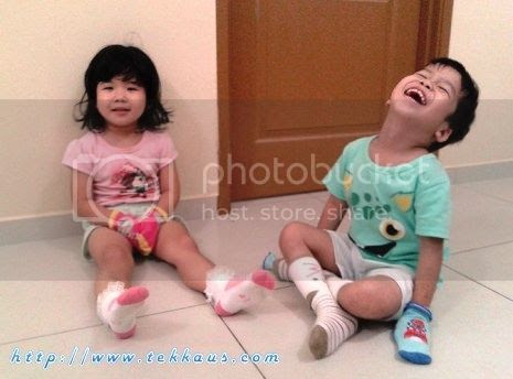 photo 03 Playing With Their Socks_zpsu2pkkdsy.jpg