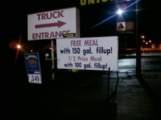 Truck stop sign: Free meal with 150gal purchase