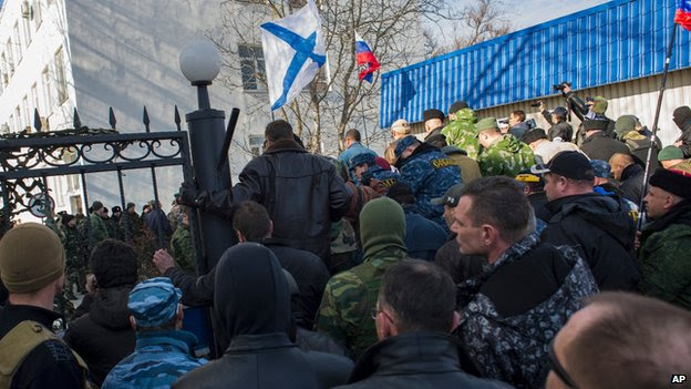 Crimean self-defence forces enter the Ukrainian naval HQ in Sevastopol on 14 March 2014