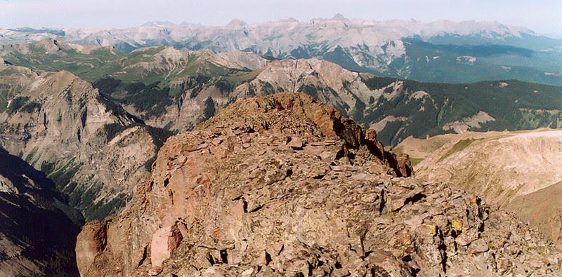 Looking down Coxcomb's summit ridge toward cleft (top center photo)