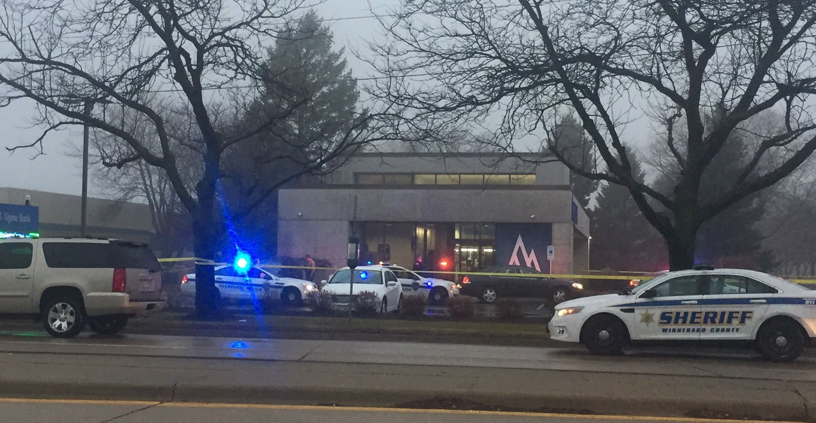 Police on the scene of a bank robbery at Alpine Bank in Rockford