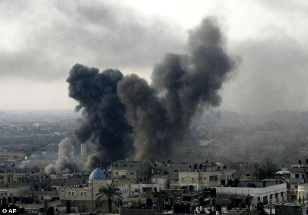 Israeli aircraft hit Gaza with at least 30 strikes overnight, hitting government ministries, smuggling tunnels, a banker's empty villa and a Hamas-linked media office