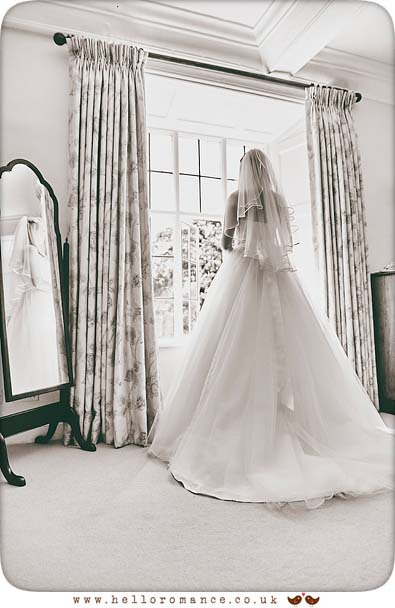 Bride at window in Bruisyard Hall - www.helloromance.co.uk