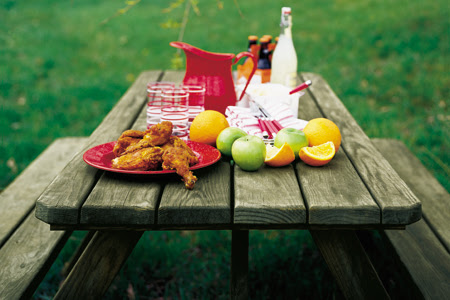 picnic bench with food on it
