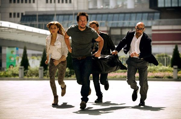 Cade Yeager, his daughter Tessa (Nicola Peltz), Shane Dyson and Joshua Joyce (Stanley Tucci) try to bring a device known as the Seed to safety in TRANSFORMERS: AGE OF EXTINCTION.