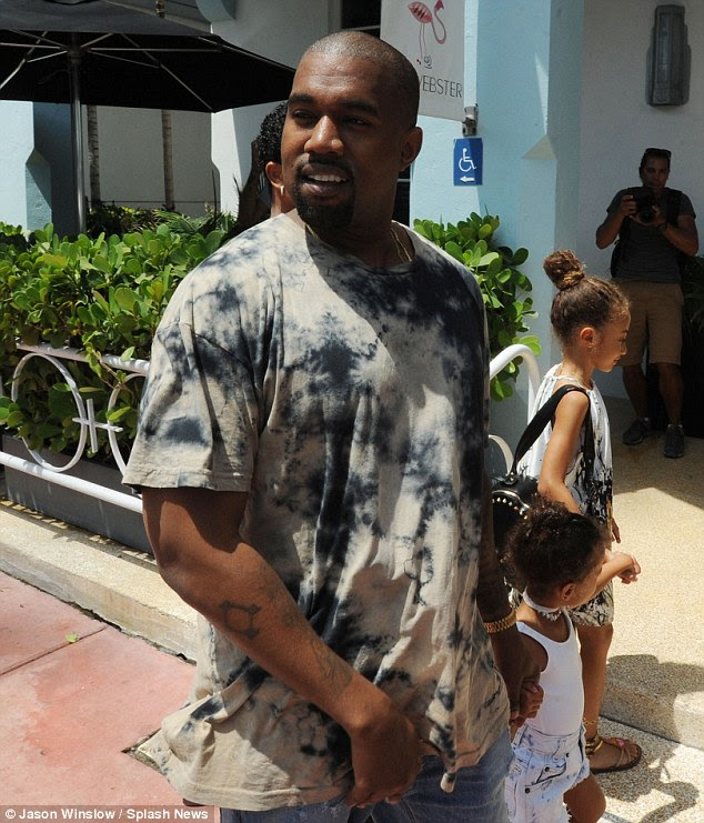 Ready to party: Kanye flew in to join Kim and Kourtney on Friday evening for a busy weekend in the Florida vacation spot