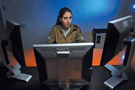 File: Former Sgt. Talia Wissner-Levy at her desk. (Jonathan Ben David/IDF)