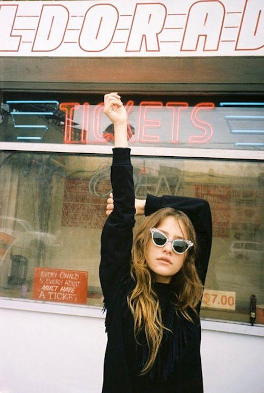 Le Fashion Blog Fall Style Tousled Hair Retro Cat Eye Sunglasses Black Fringed Knit Via Oyster