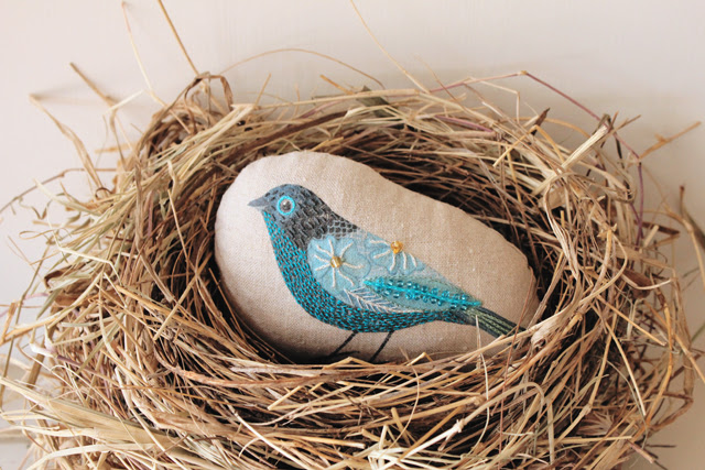 Nest with embroidered bird
