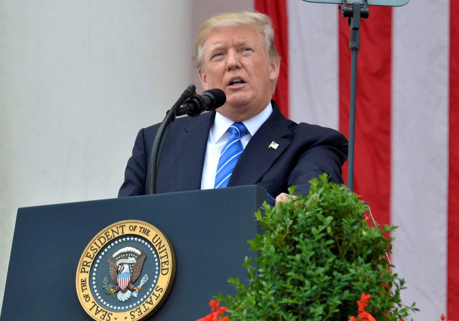 U.S. President Donald Trump makes remarks at the Amphitheater after laying a wreath at the Tomb of t