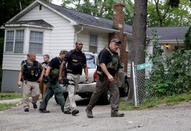 Illinois official says police officer who sparked manhunt committed suicide