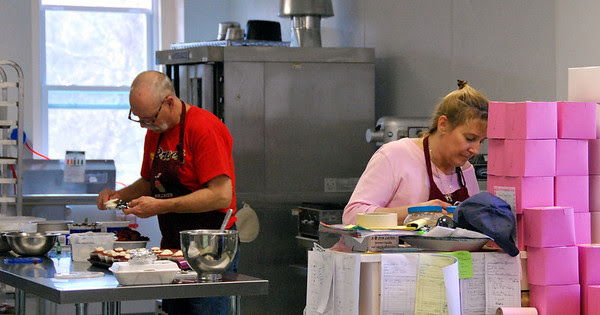 Jim and Cheryl hard at work in the kitchen