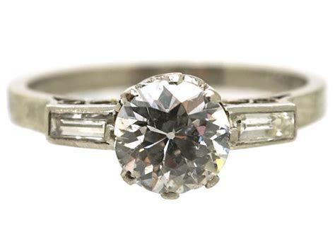 Art Deco Platinum & Diamond Solitaire Ring With Baguette