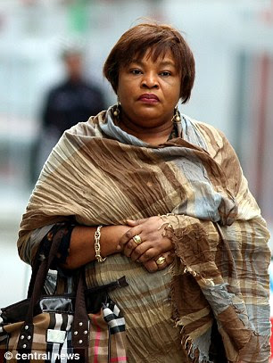 Tribunal: Mental health nurseFlorence Obadiaru, 50, (pictured outside court in 2014) has been struck off for smuggling a Nigerian woman into Britain to work as a sex slave under the threat of a voodoo curse