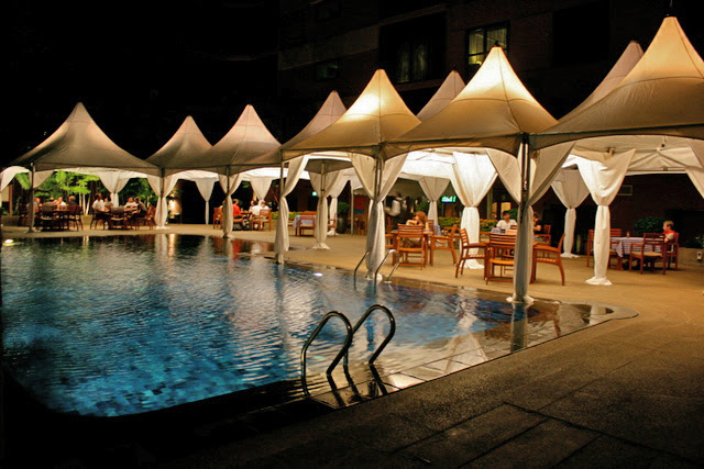 Marquees have been set up for an upcoming poolside wedding