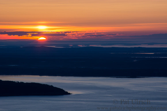 The first sliver of sunrise visible from Mount Cadillac in Acadia National Park
