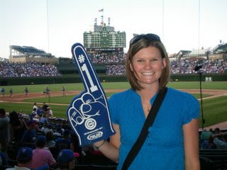 Jamie at Wrigley Field with an oversized foam Cubs are number 1 glove on