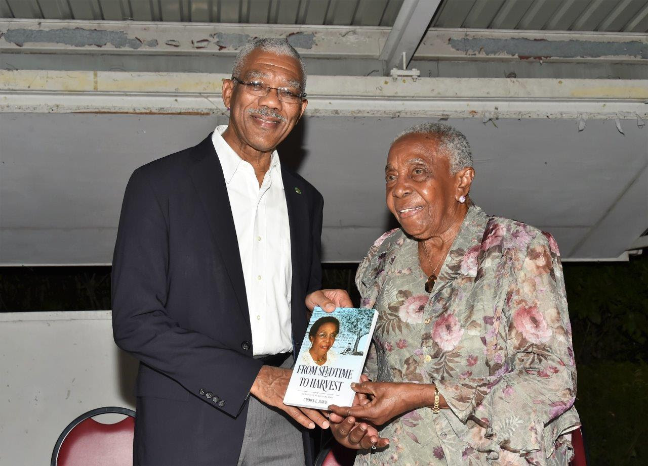Carmen Jarvis presenting a copy of her autobiography to President David Granger. (Ministry of the Presidency photo)