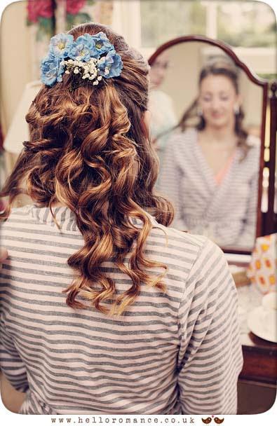 Bride preparing for wedding doing makeup hair in mirror - Hadleigh Wedding Photography Suffolk- Hello Romance