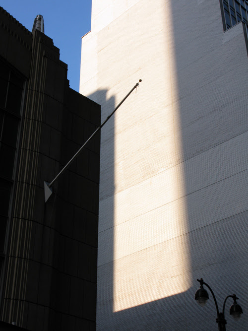composition with empty flag pole, Manhattan, NYC