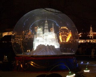 an illuminated miniture castle inside a globe, a Tivoli Gardens attraction