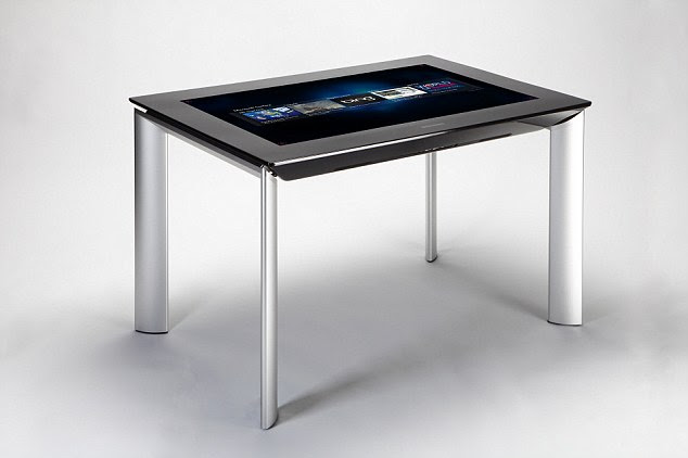 The table will also include apps that allow people to 'paint' directly onto the table, or edit photos then add them directly to their Facebook accounts