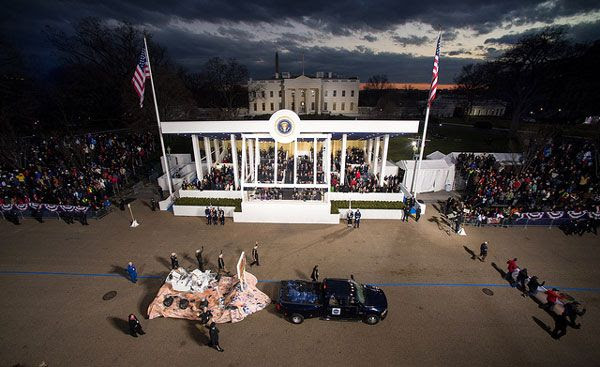 With the White House in the background, the full-size replica of NASA's Curiosity Mars rover passes by the Presidential viewing stand during the Inaugural Parade...on January 21, 2013.