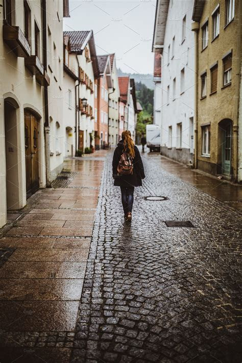Fussen old town,girl walking away ~ Architecture Photos