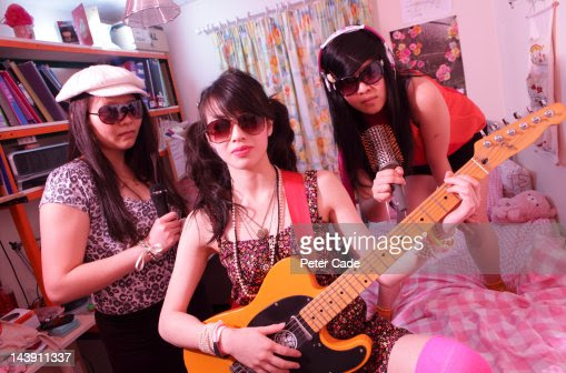 Girls In Bedroom Pretending To Be A Band Stock Photo Getty Images