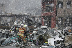 Rescue and recovery efforts: Firefighters carry out a recovered body in the snow in Otsuchi, Iwate Prefecture, on March 16, 2011, following the massive earthquake and tsunami that struck Japan on March 11. (Kyodo, used w/o permission)