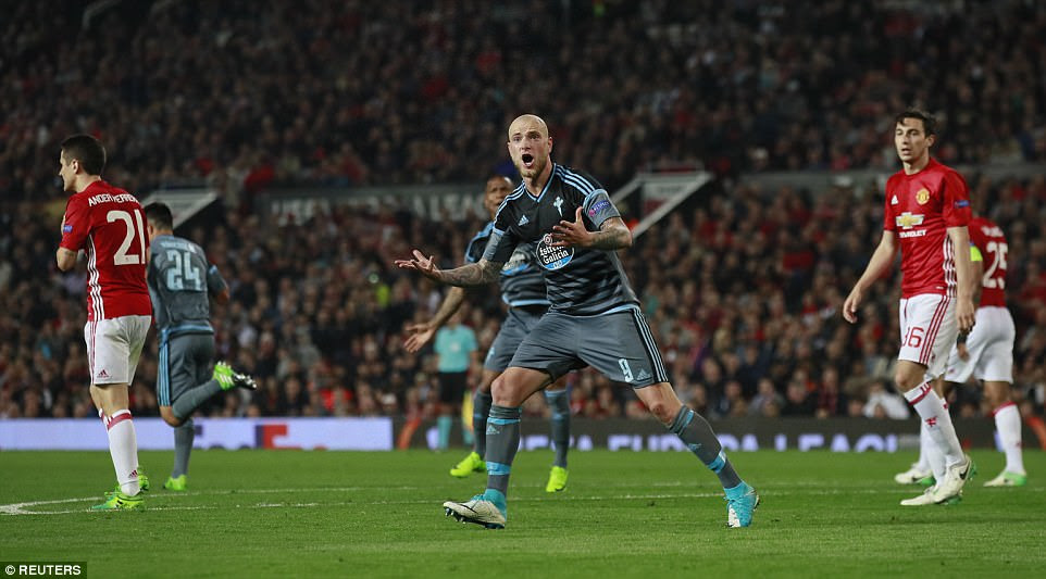 Swedish striker Guidetti (centre) gestures to the away support after Roncaglia's equalising goal at Old Trafford
