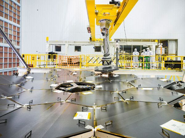 The last of 18 primary mirror segments is about to be installed onto the James Webb Space Telescope at NASA's Goddard Space Flight Center in Greenbelt, Maryland...on February 3, 2016.