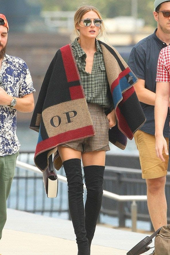 Of course she has it... New York - July 29 2014  Olivia Palermo wore a personalised Burberry Prorsum cape and Stuart Weitzman suede boots.