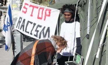 ACTIVIST YAYAUO TAGANI at anti-protest tent