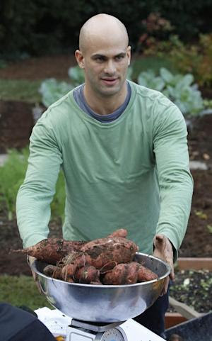 This photo taken Aug. 30, 2010, shows then Assistant White House Chef Sam Kass weighing sweet potatoes during the White House Kitchen Garden Fall Harvest with first lady Michelle Obama and students (not shown) in Washington. Kass, now White House Senior Policy Adviser for Nutrition Policy and someone President Barack Obama thinks of as family, is tying the knot Saturday evening, Aug. 30, 2014, with MSNBC host Alex Wagner in Westchester County, north of New York City, at a farm to table restaurant that's a favorite of both Kass and first lady Michelle Obama. The first family will be among the guests at the ceremony. (AP Photo/Charles Dharapak)