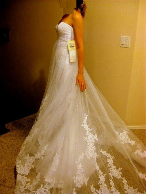 2 dress bride. Need help selling unworn gown: Pronovias