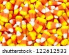 Pile of candy corn for halloween. - stock photo