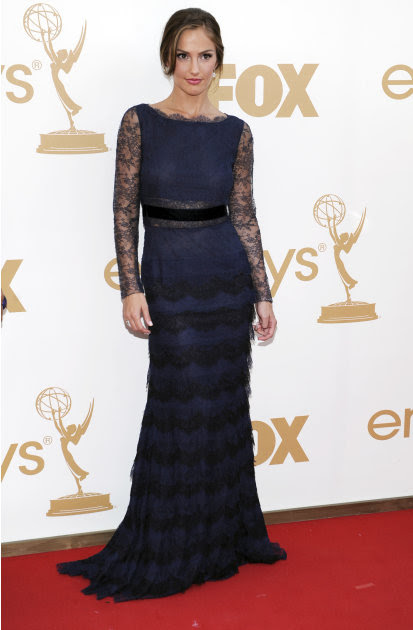 Minka Kelly arrives at the 63rd Primetime Emmy Awards on Sunday, Sept. 18, 2011 in Los Angeles. (AP Photo/Chris Pizzello)