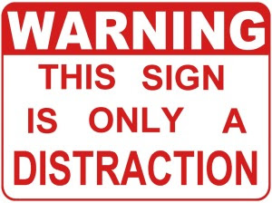 http://chaukeedaar.files.wordpress.com/2011/12/warning_this_sign_is_only_a_distraction.jpg?w=300&h=225