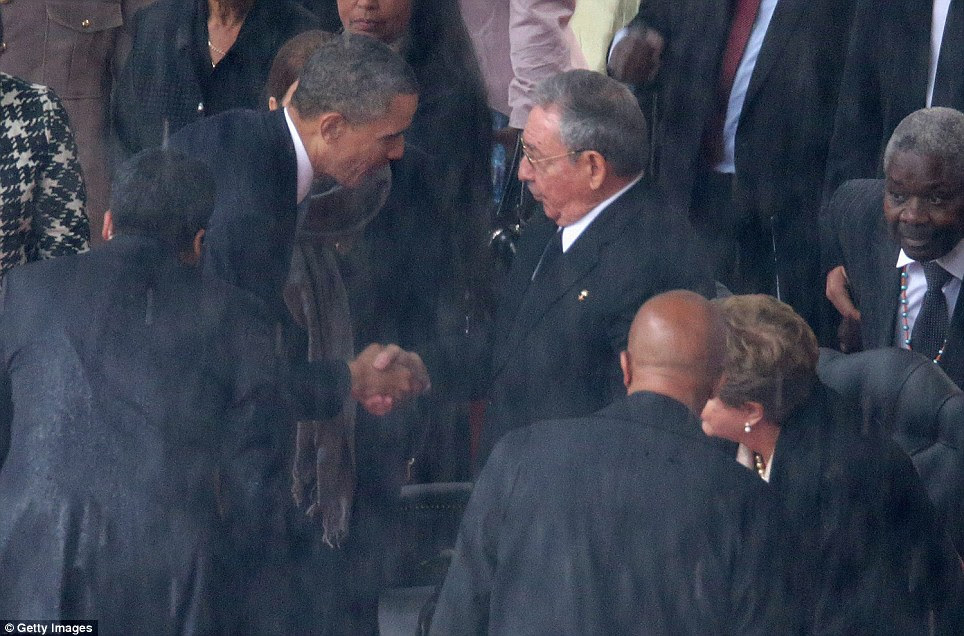 Rare display of unity: President Obama shakes hands with Cuban leader Raul Castro in spite of the animosity between them