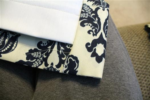 Miter bottom corners of curtain panels