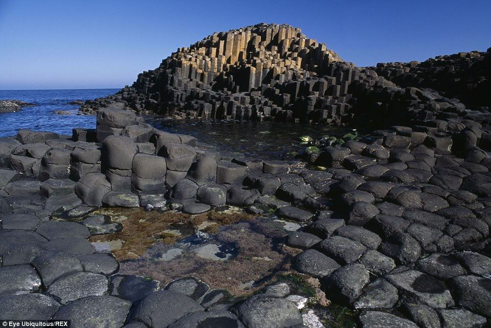 Rugged beauty:Giant¿s Causeway is a series of nearly 40,000 basalt columns of cooled molten lava in County Antrim on the northeast coast of Northern Ireland
