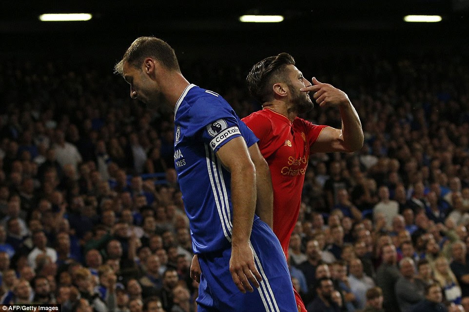 England goalscorer Adam Lallana (right) complains to the referee about the Blues defender's aggressive approach