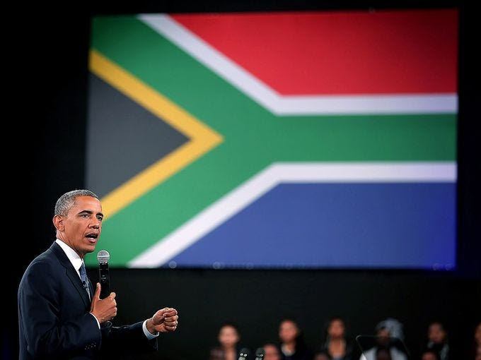 President Obama answers questions from the audience and from people in Nigeria, Uganda and Kenya during a town hall meeting with the young African leaders at the University of Johannesburg on June 29 in Soweto, South Africa.