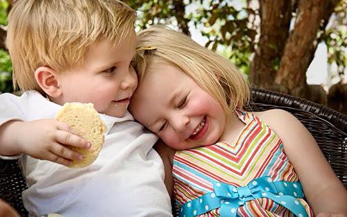 [Photo of two children hugging]