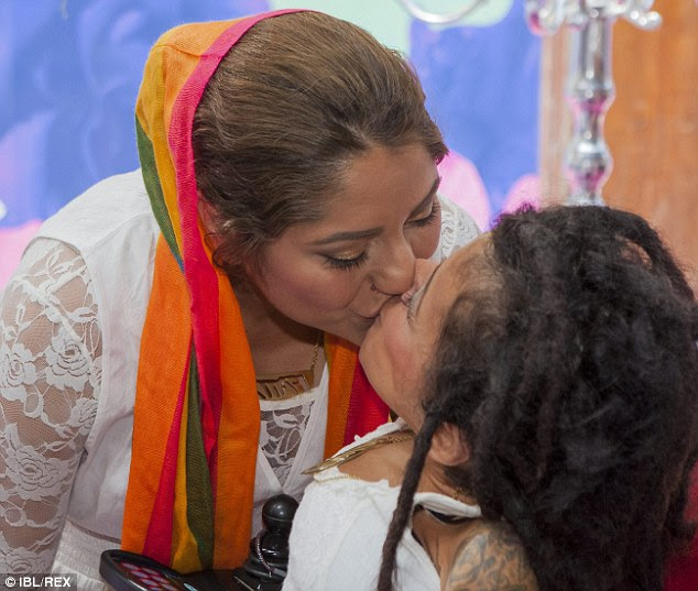 Sealed with a kiss: The couple pucker up after completing the ceremony conducted by Imam Zahed