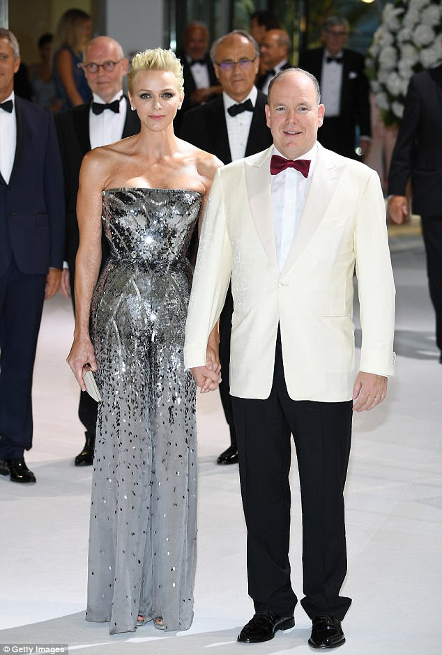 Silver stunner: Joining her at the bash was Charlene, Princess of Monaco and her husband Prince Albert II, with both the couple looking dashing in chic ensembles
