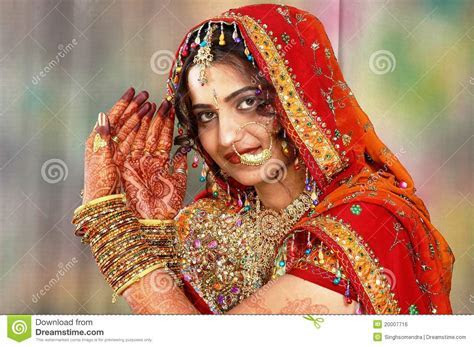 Indian Bride In Her Wedding Dress Showing Henna Stock