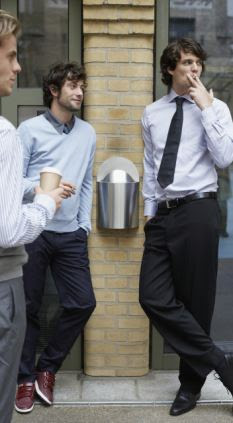 Four in ten smokers have admitted to 'lingering' outside for nearly five minutes after finishing their cigarette to avoid work (file picture)