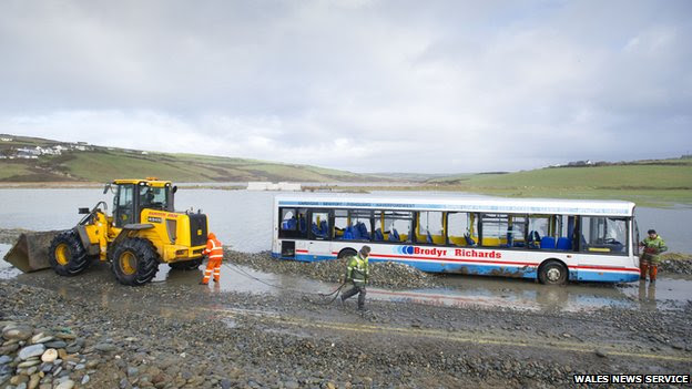 Workers clearing the road by the bus stranded in Newgale